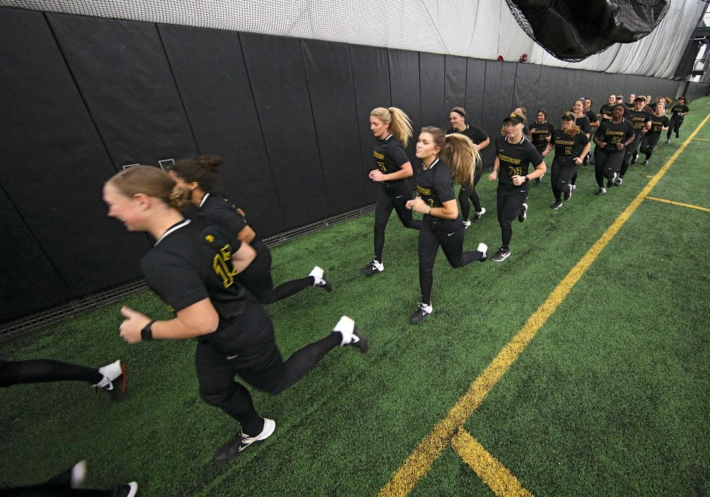 The Hawkeyes run to warm up for practice during Iowa Softball Media Day at the Hawkeye Tennis and Recreation Complex in Iowa City on Thursday, January 30, 2020. (Stephen Mally/hawkeyesports.com)