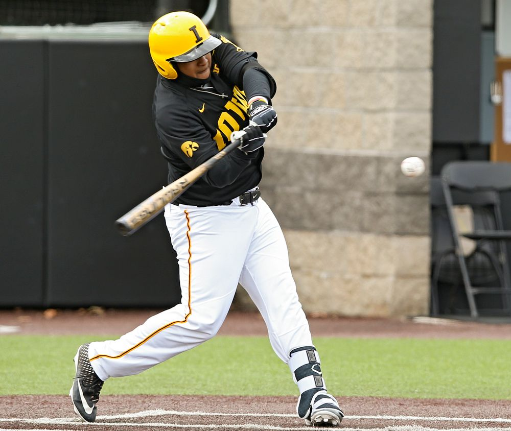 Iowa Hawkeyes first baseman Izaya Fullard (20) bats during the first inning of their game against Illinois at Duane Banks Field in Iowa City on Saturday, Mar. 30, 2019. (Stephen Mally/hawkeyesports.com)