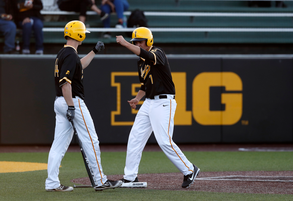 Iowa Hawkeyes pitcher Grant Judkins (7) and outfielder Robert Neustrom (44) against Milwaukee Wednesday, April 25, 2018 at Duane Banks Field. (Brian Ray/hawkeyesports.com)