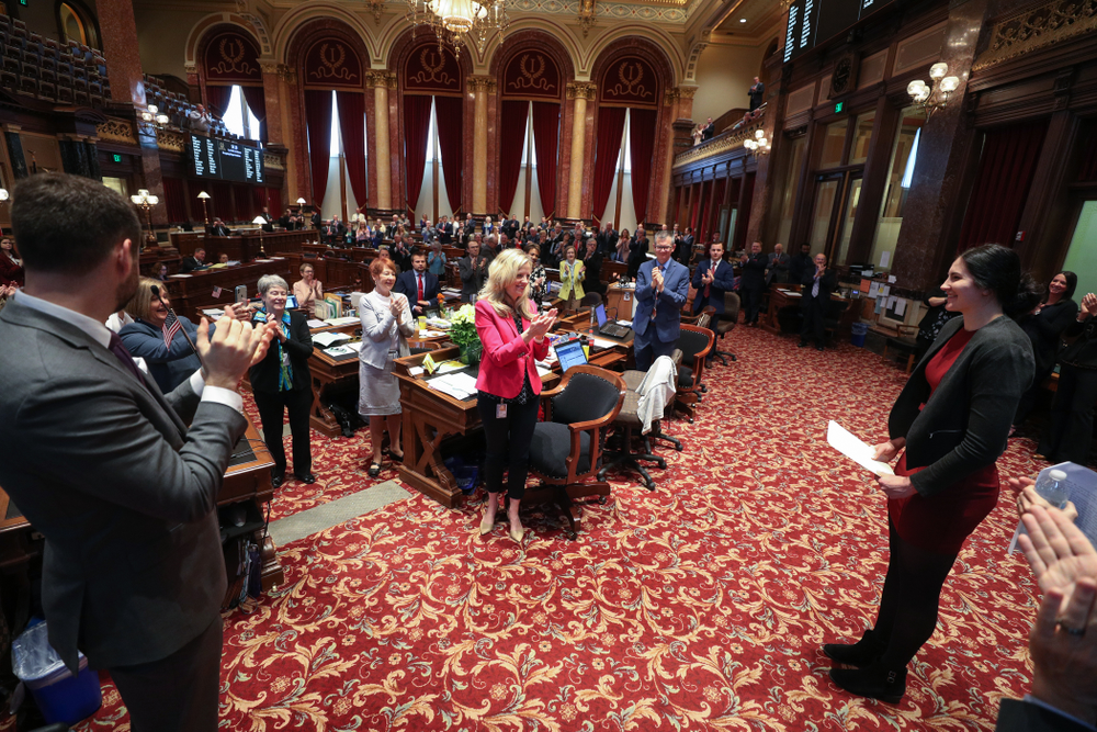 Iowa's Megan Gustafson shakes hands with state senator Zach Wahls  after being recognized with a resolution in the senate chamber at the Iowa State Capitol Wednesday, April 24, 2019 in Des Moines. (Brian Ray/hawkeyesports.com)