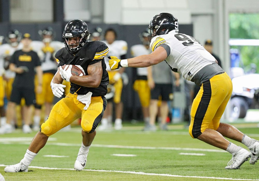 Iowa Hawkeyes running back Toren Young (28) gets around defensive end A.J. Epenesa (94) during Fall Camp Practice No. 6 at the Hansen Football Performance Center in Iowa City on Thursday, Aug 8, 2019. (Stephen Mally/hawkeyesports.com)