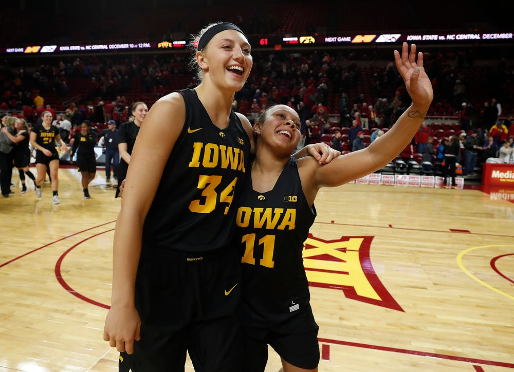 Iowa Hawkeyes forward Carly Mohns (34) and guard Tania Davis (11)