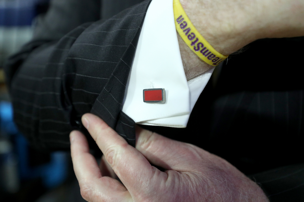 Iowa Hawkeyes head coach Fran McCaffery wears cuff links made from the floor at the Palestra during their game against Penn State Saturday, January 4, 2020 at the Palestra in Philadelphia. (Brian Ray/hawkeyesports.com)
