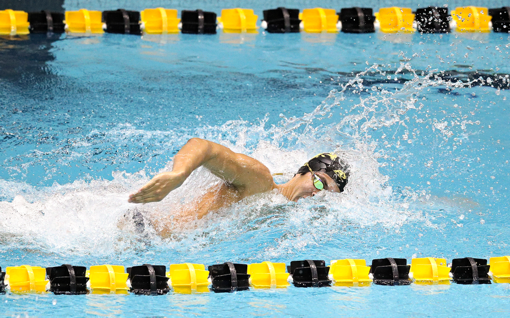 Iowa's Preston Planells swims the men's 100 yard individual medley event during their meet at the Campus Recreation and Wellness Center in Iowa City on Friday, February 7, 2020. (Stephen Mally/hawkeyesports.com)