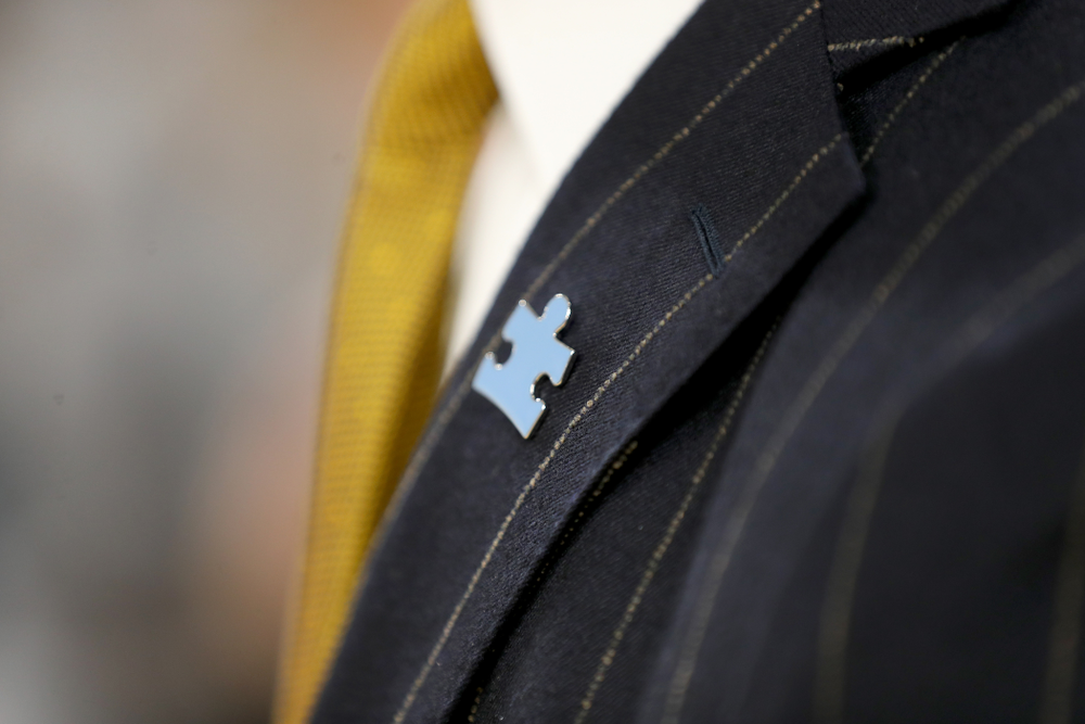 The Iowa Hawkeyes coaching staff wears Autism Awareness pins against Illinois Fighting Illini Sunday, February 2, 2020 at Carver-Hawkeye Arena. (Brian Ray/hawkeyesports.com)