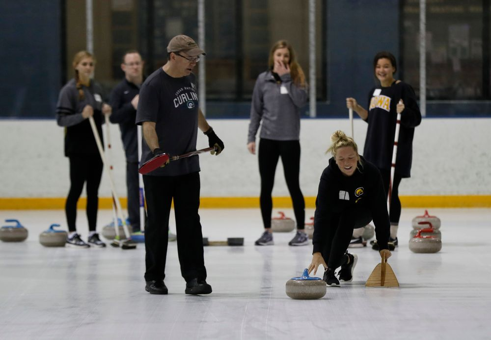 Members of the Iowa Softball team learn the sport of curling as part of a team building event Wednesday, January 10, 2018 at the Cedar Rapids Ice Arena. (Brian Ray/hawkeyesports.com)