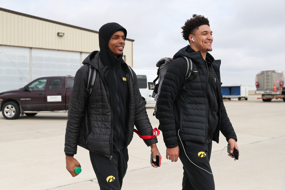 Iowa Hawkeyes guard Maishe Dailey (1) and forward Cordell Pemsl (35) board a flight to Columbus for the first and second rounds of the 2019 NCAA Men's Basketball Tournament Wednesday, March 20, 2019 at the Eastern Iowa Airport. (Brian Ray/hawkeyesports.com)