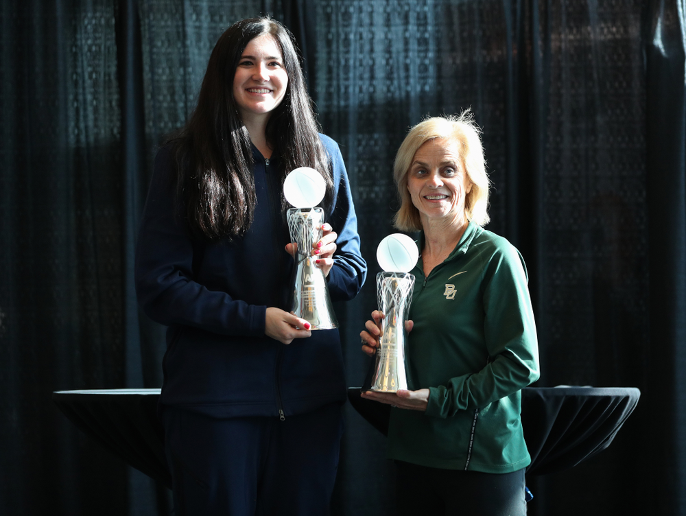 Iowa Hawkeyes forward Megan Gustafson (10) stands with Baylor Lady Bears head coach Kim Mulkey during a news conference to announce that Gustafson had won the AP Player of the Year and Mulkey had won the AP Coach of the Year  Wednesday, April 4, 2018 at Amalie Arena in Tampa, FL. (Brian Ray/hawkeyesports.com)