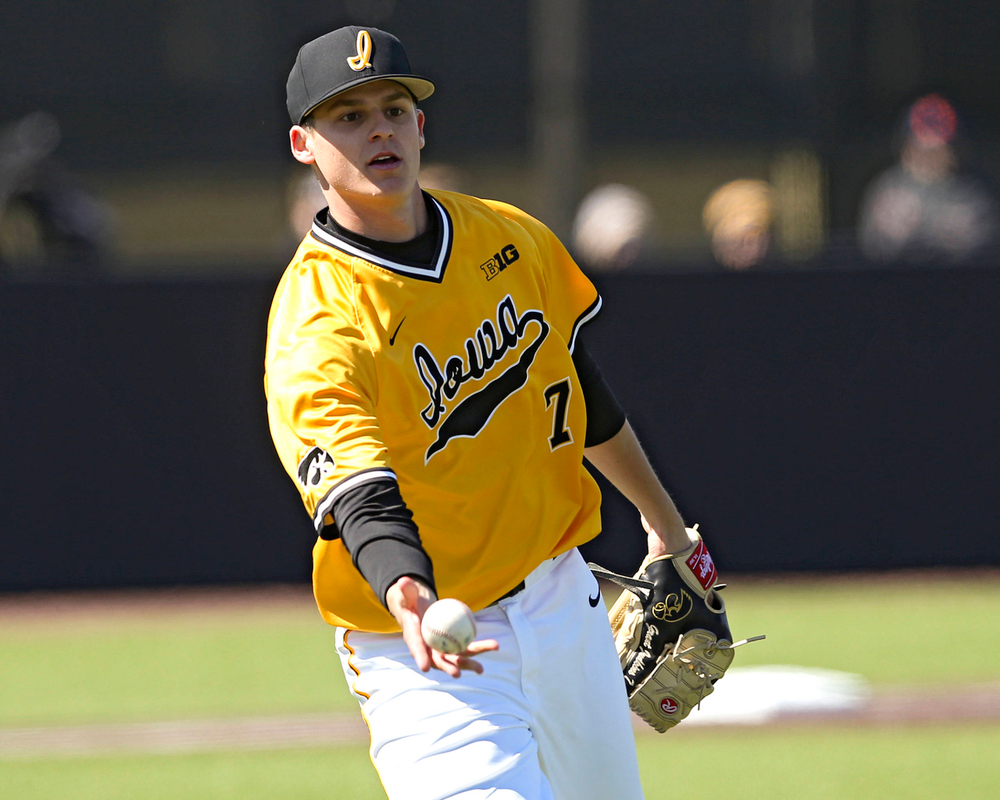 Iowa Hawkeyes pitcher Grant Judkins (7) tosses the ball to first base for an out during the fourth inning against Illinois at Duane Banks Field in Iowa City on Sunday, Mar. 31, 2019. (Stephen Mally/hawkeyesports.com)