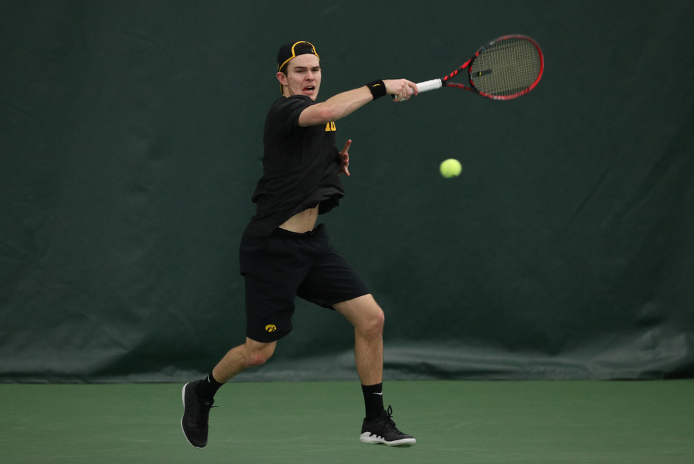 Iowa's Jonas Larsen against UMKC Friday, February 15, 2019 at the Hawkeye Tennis and Recreation Complex. (Brian Ray/hawkeyesports.com)