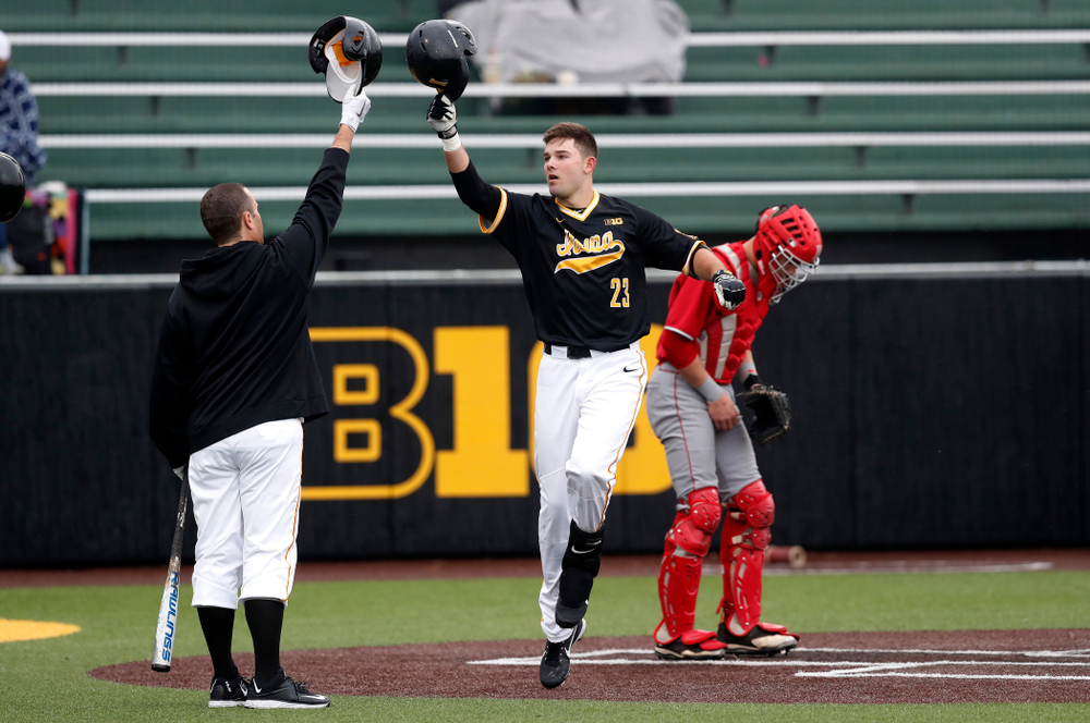 Iowa Hawkeyes infielder Kyle Crowl (23) celebrates after hitting a home-run against the Bradley Braves Wednesday, March 28, 2018 at Duane Banks Field. (Brian Ray/hawkeyesports.com)