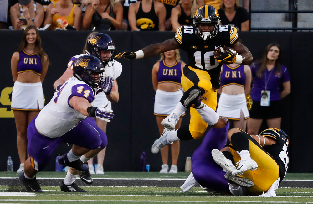 Iowa Hawkeyes running back Mekhi Sargent (10) hurdles a defender during a game against Northern Iowa at Kinnick Stadium on September 15, 2018. (Tork Mason/hawkeyesports.com)