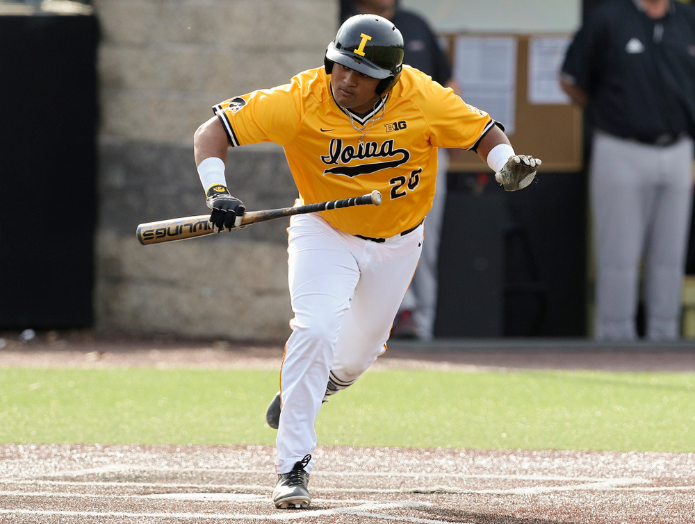 Iowa Hawkeyes first baseman Izaya Fullard (20) tosses his bat after walking during the third inning of their game against Northern Illinois at Duane Banks Field in Iowa City on Tuesday, Apr. 16, 2019. (Stephen Mally/hawkeyesports.com)