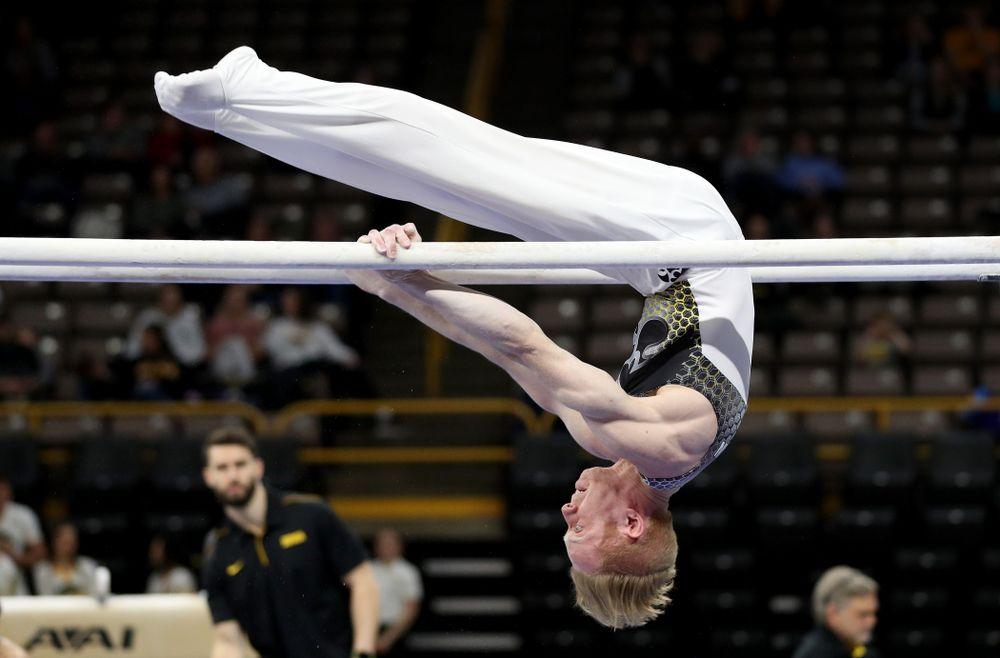 Iowa's Nick Merryman competes on the parallel bars against UIC and Minnesota Saturday, February 1, 2020 at Carver-Hawkeye Arena. (Brian Ray/hawkeyesports.com)