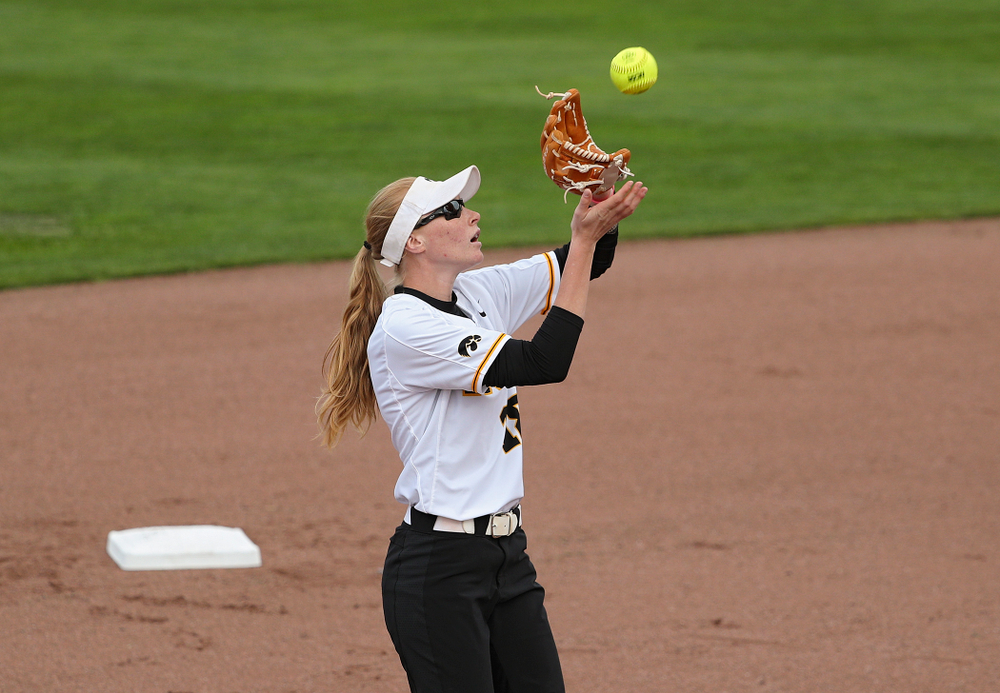 Iowa shortstop Ashley Hamilton (18) pulls in a pop fly for an out during the first inning of their game against Ohio State at Pearl Field in Iowa City on Friday, May. 3, 2019. (Stephen Mally/hawkeyesports.com)
