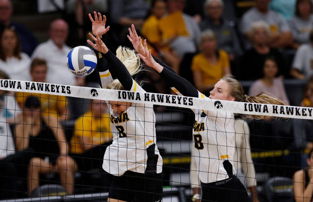 Iowa Hawkeyes right side hitter Reghan Coyle (8) and middle blocker Hannah Clayton (18) against Eastern Illinois Sunday, September 9, 2018 at Carver-Hawkeye Arena. (Brian Ray/hawkeyesports.com)