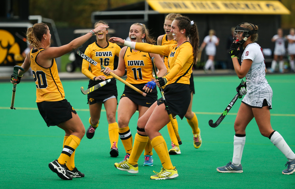 Iowa Hawkeyes midfielder Sophie Sunderland (20) celebrates with her teammates after scoring a goal during a game against Stanford at Grant Field on October 7, 2018. (Tork Mason/hawkeyesports.com)