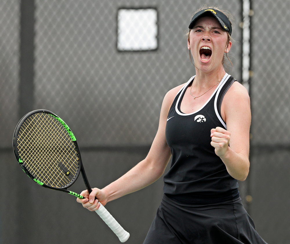 Iowa's Samantha Mannix celebrates after winning her match against Rutgers at the Hawkeye Tennis and Recreation Complex in Iowa City on Friday, Apr. 5, 2019. (Stephen Mally/hawkeyesports.com)