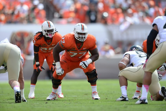 University of Miami Hurricanes offensive lineman Seantrel Henderson #77 gets set to block against the Wake Forest Demon Deacons at Sun Life Stadium on...
