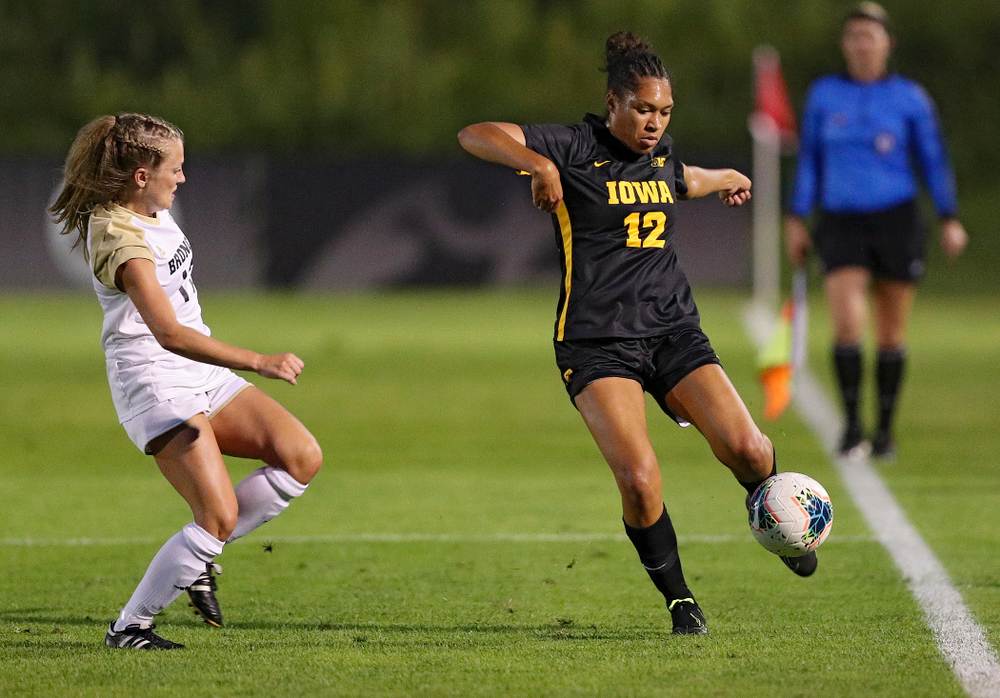 Iowa forward Olivia Fiegel (12) passes the ball during the second half of their match against Western Michigan at the Iowa Soccer Complex in Iowa City on Thursday, Aug 22, 2019. (Stephen Mally/hawkeyesports.com)