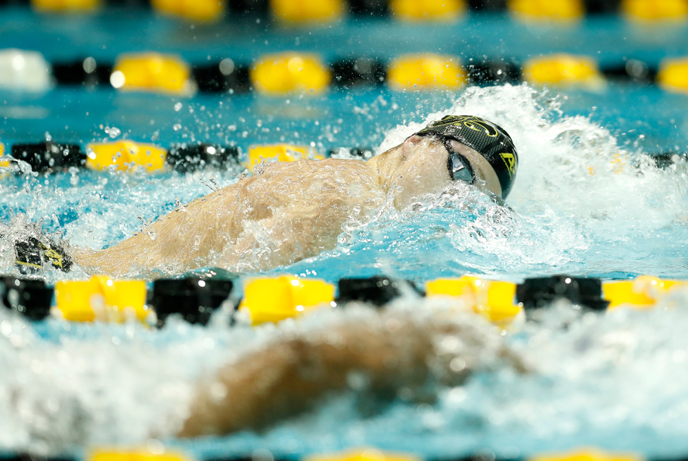 Joe Myhre competes in the 100 yard freestyle