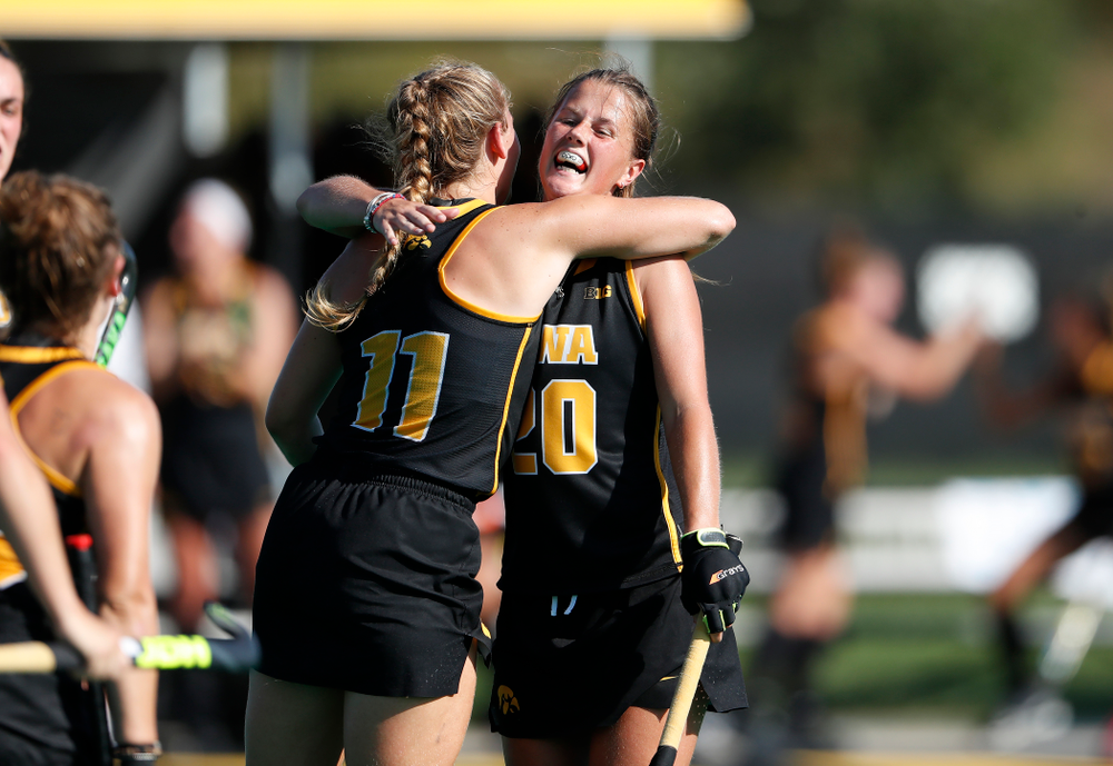 Iowa Hawkeyes Katie Birch (11) hugs Sophie Sunderland (20) after scoring against the Penn Quakers Friday, September 14, 2018 at Grant Field. (Brian Ray/hawkeyesports.com)