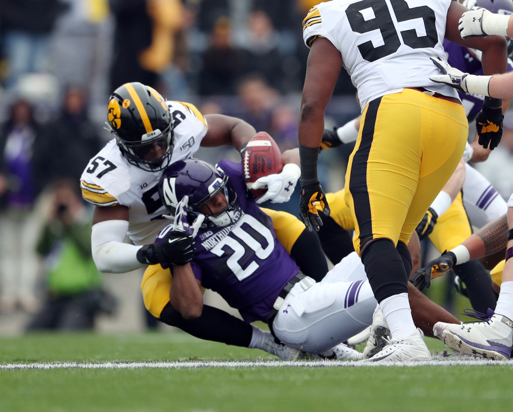 Iowa Hawkeyes defensive end Chauncey Golston (57) makes a tackle against the Northwestern Wildcats Saturday, October 26, 2019 at Ryan Field in Evanston, Ill. (Brian Ray/hawkeyesports.com)