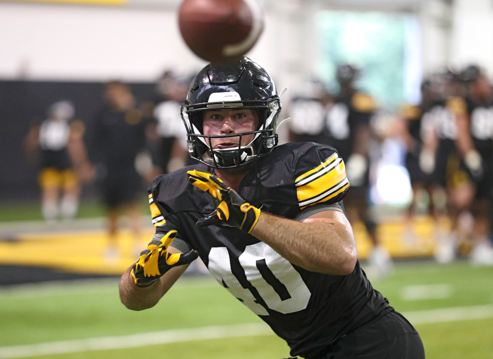 Iowa Hawkeyes fullback Turner Pallissard (40) pulls in a pass during Fall Camp Practice No. 9 at the Hansen Football Performance Center in Iowa City on Monday, Aug 12, 2019. (Stephen Mally/hawkeyesports.com)