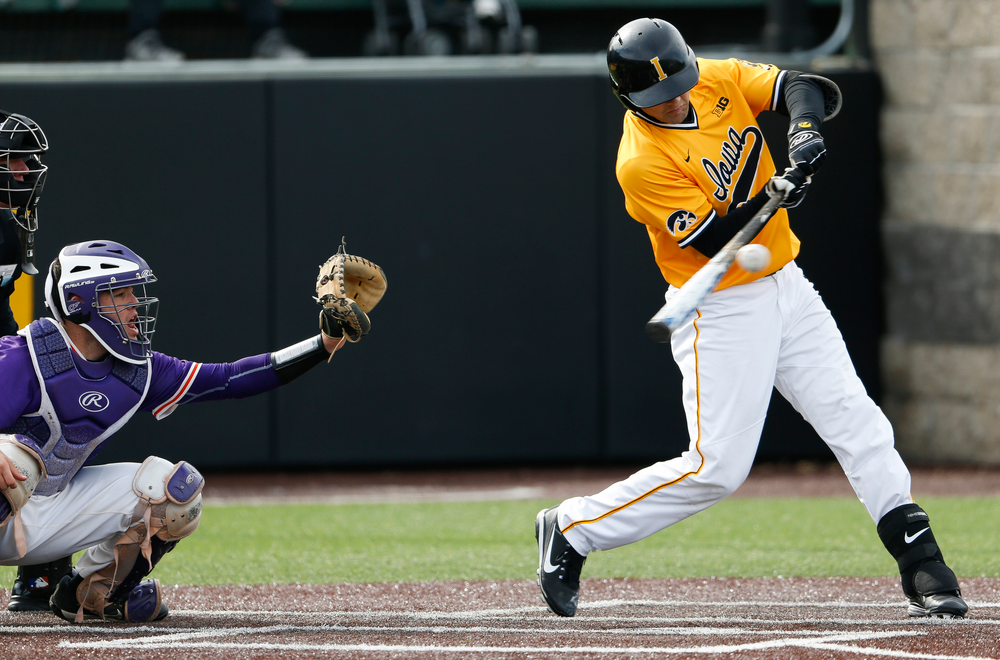 Iowa Hawkeyes infielder Kyle Crowl (23) swings at a pitch during a game against Evansville at Duane Banks Field on March 18, 2018. (Tork Mason/hawkeyesports.com)