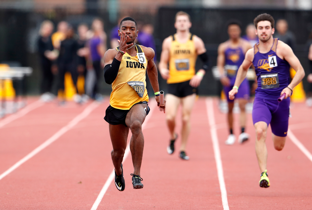 Iowa's Antonio Woodard runs the final leg of 4x100 during the 2018 MUSCO Twilight Invitational  Thursday, April 12, 2018 at the Cretzmeyer T