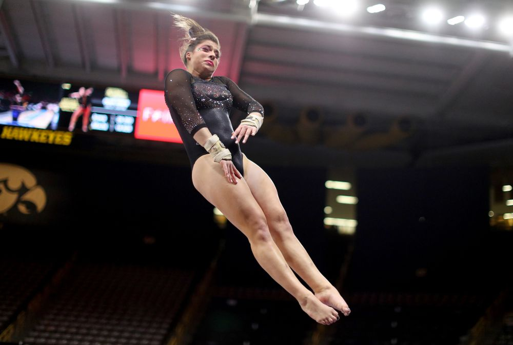 Iowa's Ariana Agrapides competes on the vault against Michigan Friday, February 14, 2020 at Carver-Hawkeye Arena. (Brian Ray/hawkeyesports.com)