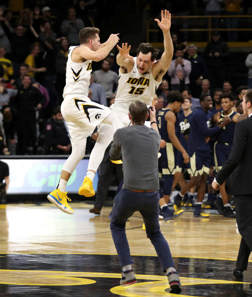 Iowa Hawkeyes guard Jordan Bohannon (3) and forward Ryan Kriener (15) celebrate their victory against the Pitt Panthers Tuesday, November 27, 2018 at Carver-Hawkeye Arena. (Brian Ray/hawkeyesports.com)