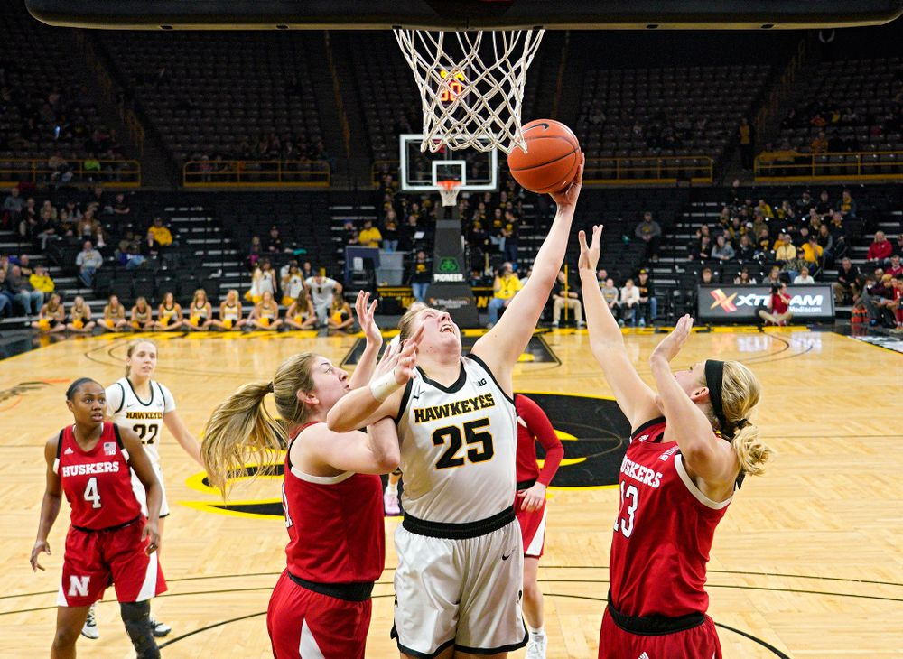 Iowa Hawkeyes forward Monika Czinano (25) pulls in a rebound during the third quarter of the game at Carver-Hawkeye Arena in Iowa City on Thursday, February 6, 2020. (Stephen Mally/hawkeyesports.com)