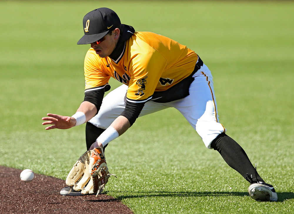 Iowa Hawkeyes second baseman Mitchell Boe (4) fields a ground ball during the eighth inning against Illinois at Duane Banks Field in Iowa City on Sunday, Mar. 31, 2019. (Stephen Mally/hawkeyesports.com)