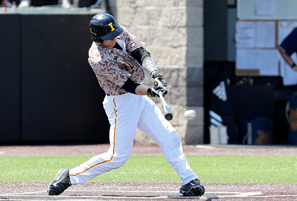 Iowa Hawkeyes catcher Austin Martin (34) drives a pitch for a hit during the third inning of their game against UC Irvine at Duane Banks Field in Iowa City on Sunday, May. 5, 2019. (Stephen Mally/hawkeyesports.com)