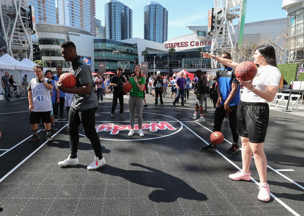 Iowa Hawkeyes forward Megan Gustafson (10) runs a drill with Zion Williamson during a Special Olympics event Friday, April 12, 2019 as part of the ESPN College Basketball Awards in the XBOX Plaza at LA Live.  (Brian Ray/hawkeyesports.com)