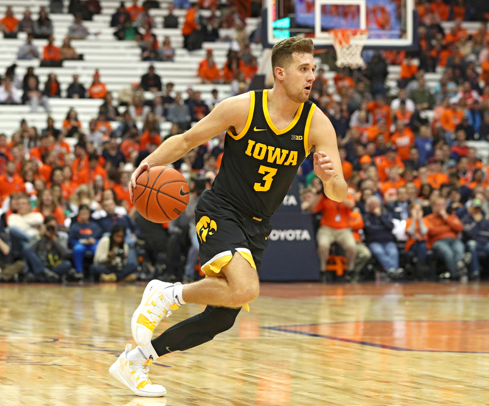 Iowa Hawkeyes guard Jordan Bohannon (3) drives with the ball during the second half of their ACC/Big Ten Challenge game at the Carrier Dome in Syracuse, N.Y. on Tuesday, Dec 3, 2019. (Stephen Mally/hawkeyesports.com)
