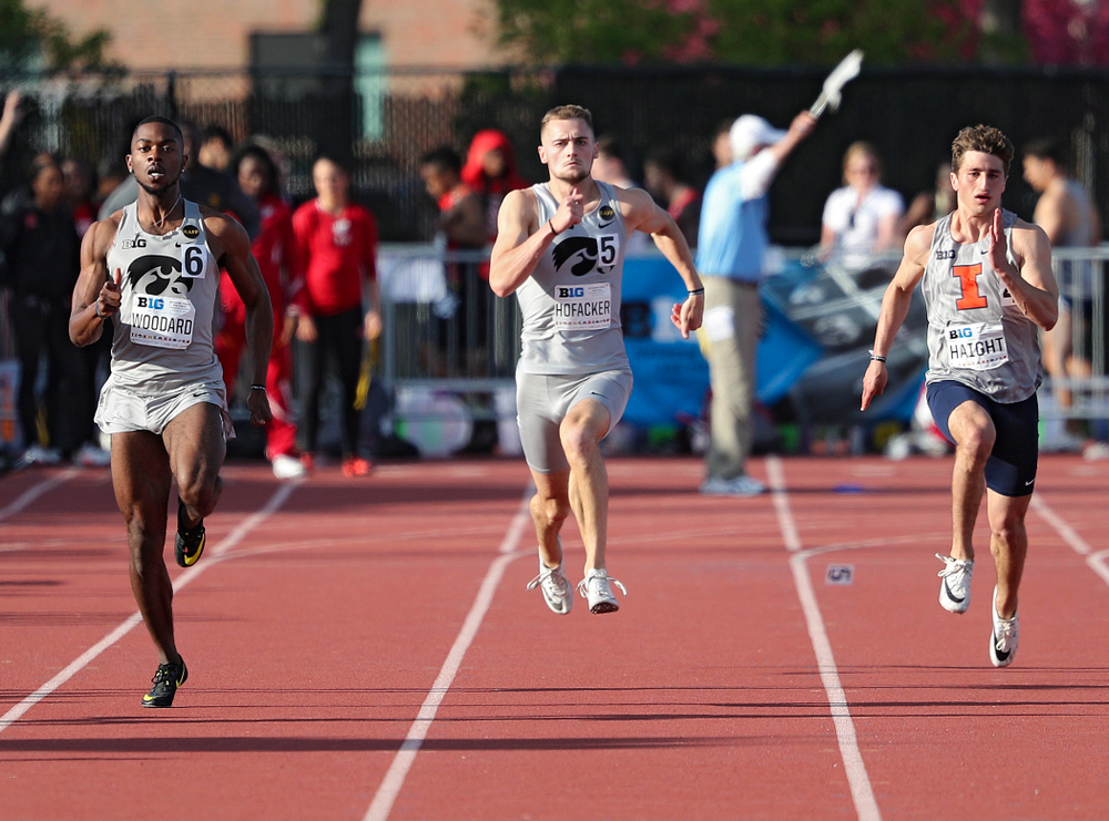 Iowa's Antonio Woodard and Collin Hofacker runs the men's 200 meter dash event on the first day of the Big Ten Outdoor Track and Field Championships at Francis X. Cretzmeyer Track in Iowa City on Friday, May. 10, 2019. (Stephen Mally/hawkeyesports.com)