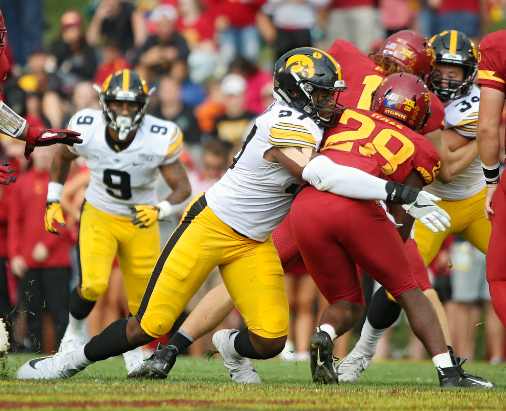 Iowa Hawkeyes defensive end Chauncey Golston (57) makes a tackle during the first quarter of their Iowa Corn Cy-Hawk Series game at Jack Trice Stadium in Ames on Saturday, Sep 14, 2019. (Stephen Mally/hawkeyesports.com)