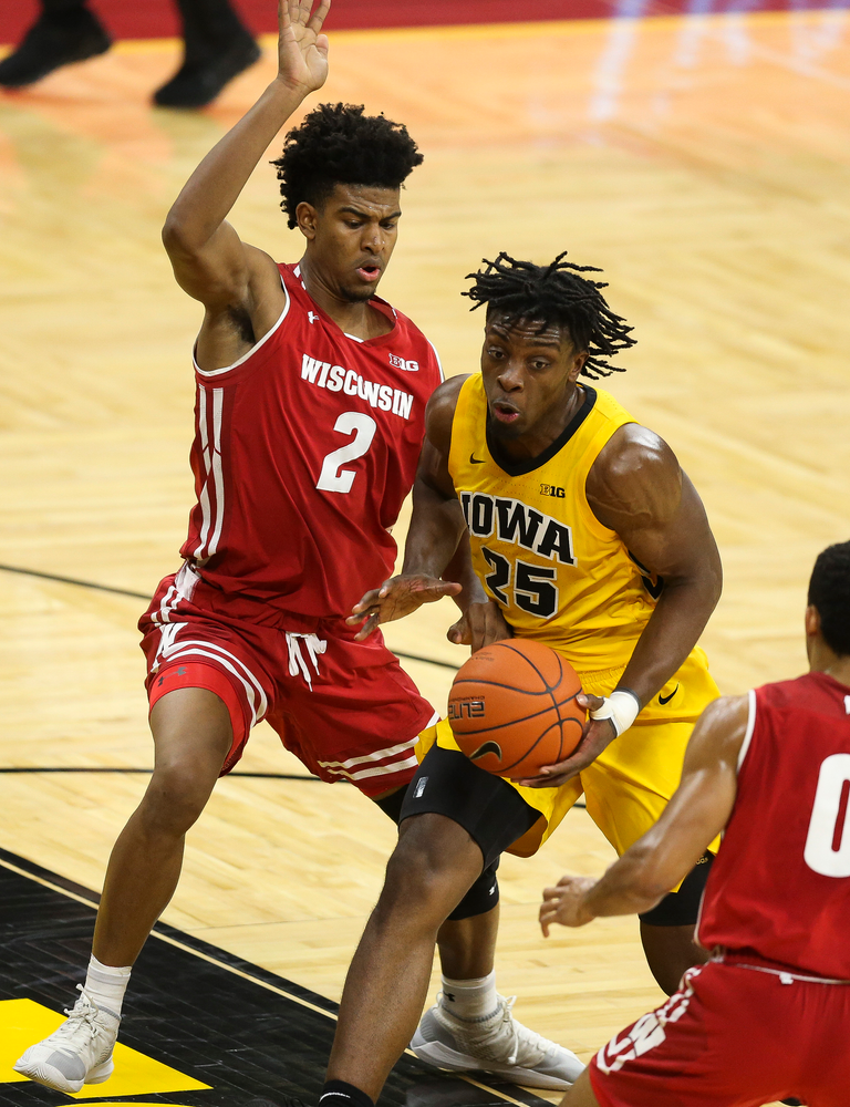 Iowa Hawkeyes forward Tyler Cook (25) drives to the basket against Wisconsin on November 30, 2018 at Carver-Hawkeye Arena. (Tork Mason/hawkeyesports.com)