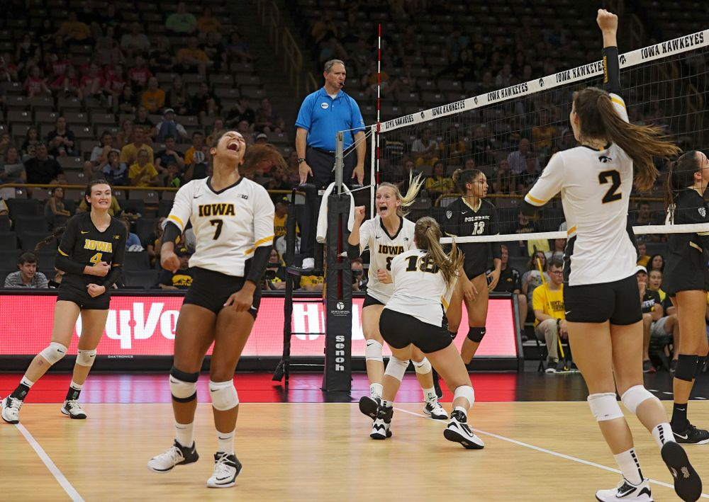Iowa's Halle Johnston (4), Brie Orr (7), Hannah Clayton (18), and Courtney Buzzerio (2) celebrate with Kyndra Hansen (8) after her kill during the third set of their Big Ten/Pac-12 Challenge match against Colorado at Carver-Hawkeye Arena in Iowa City on Friday, Sep 6, 2019. (Stephen Mally/hawkeyesports.com)