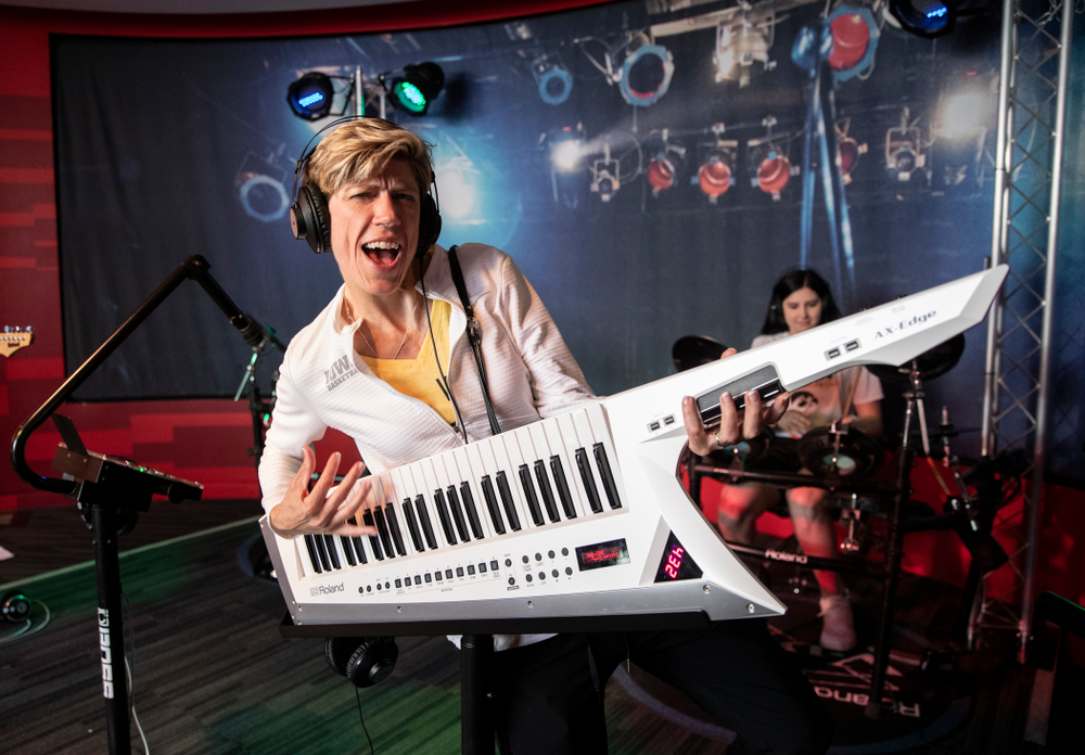 Iowa Hawkeyes associate head coach Jan Jensen plays the keytar in a exhibit at the Grammy Museum Friday, April 12, 2019 in downtown LA. (Brian Ray/hawkeyesports.com)
