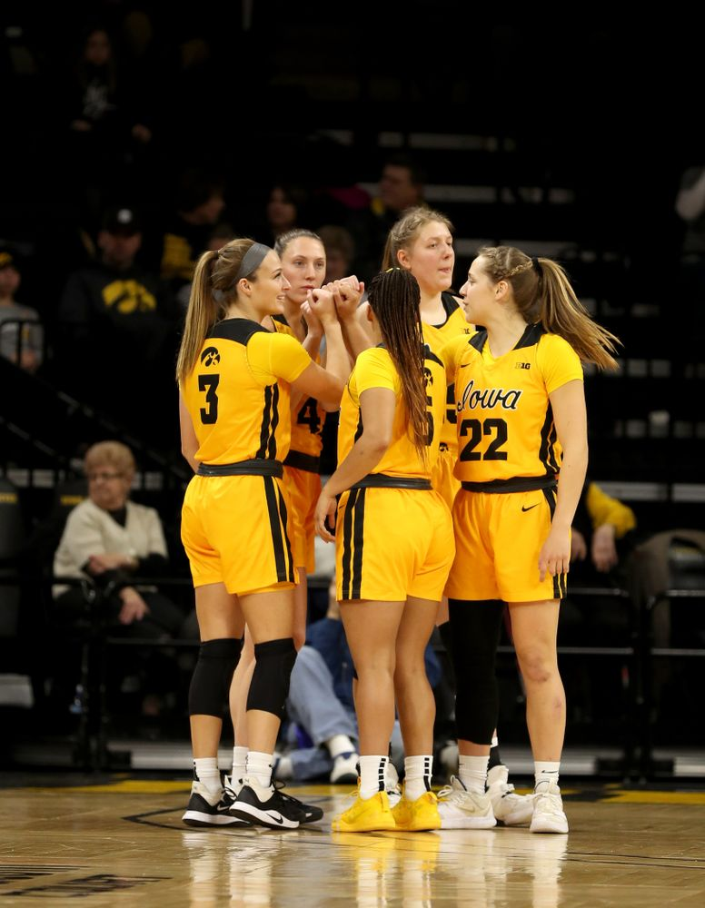 Iowa Hawkeyes guard Makenzie Meyer (3), forward Amanda Ollinger (43), forward/center Monika Czinano, guard Kathleen Doyle (22), and guard Alexis Sevillian (5) against the Minnesota Golden Gophers Thursday, February 27, 2020 at Carver-Hawkeye Arena. (Brian Ray/hawkeyesports.com)