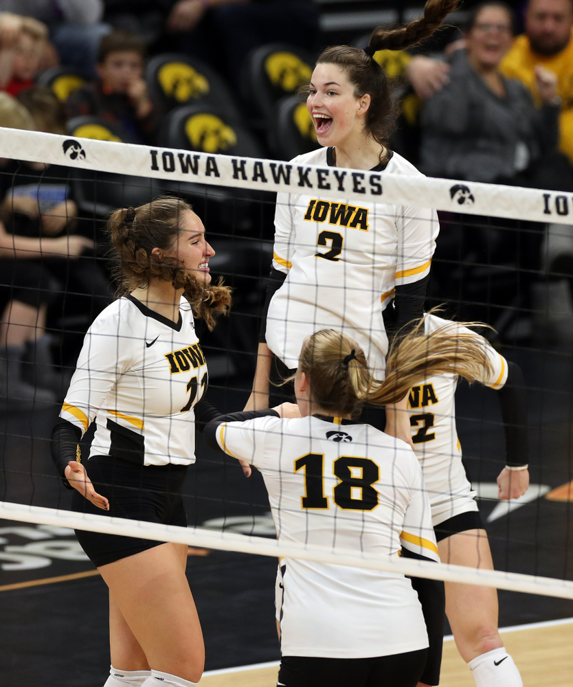 Iowa Hawkeyes middle blocker Blythe Rients (11), setter Courtney Buzzerio (2), and middle blocker Hannah Clayton (18) against Penn State Friday, November 1, 2019 at Carver Hawkeye Arena. (Brian Ray/hawkeyesports.com)