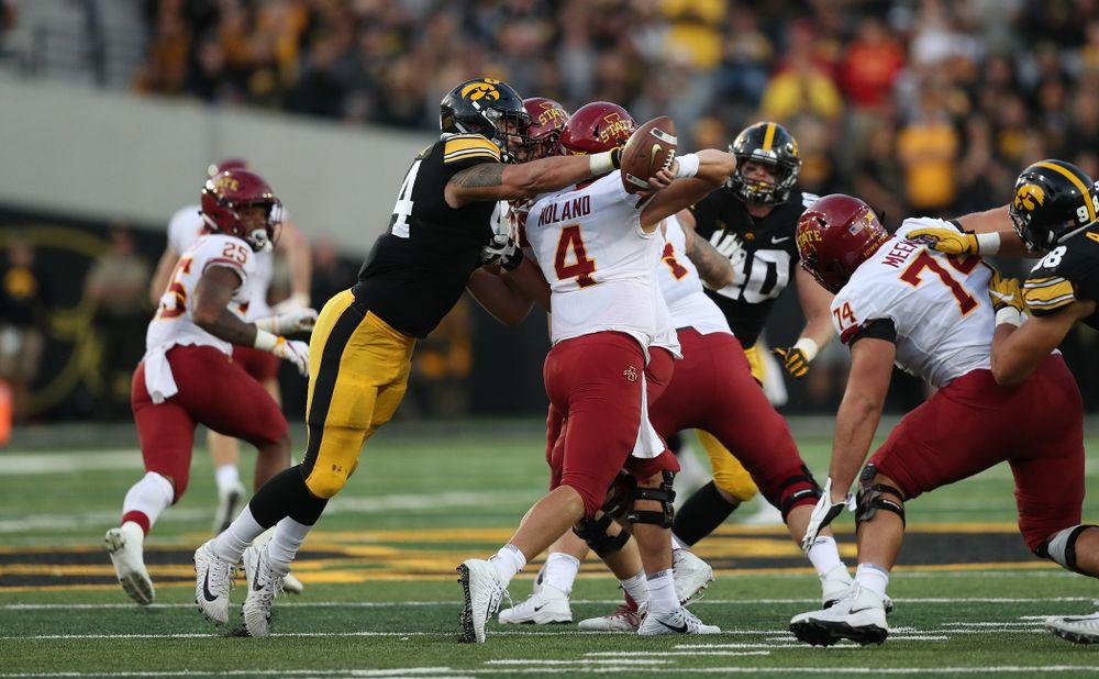 Iowa Hawkeyes defensive end A.J. Epenesa (94) strips the ball from Iowa State Cyclones quarterback Zeb Noland (4) Saturday, September 8, 2018 at Kinnick Stadium. (Max Allen/hawkeyesports.com)