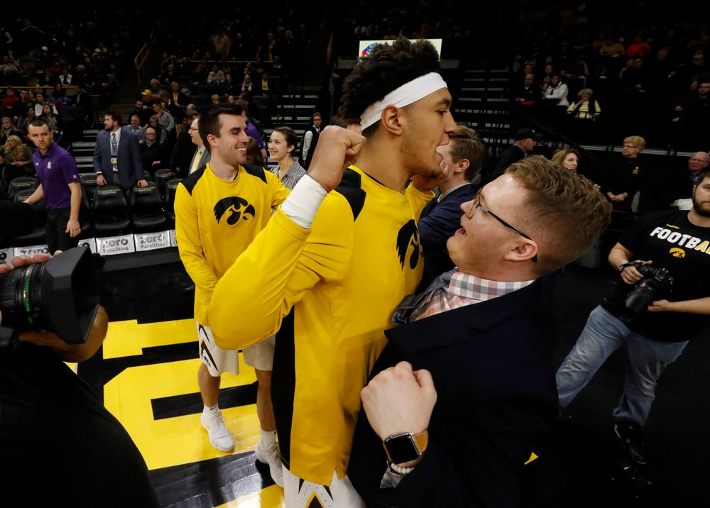 Iowa Hawkeyes forward Cordell Pemsl (35) and manager Lucas Pauley