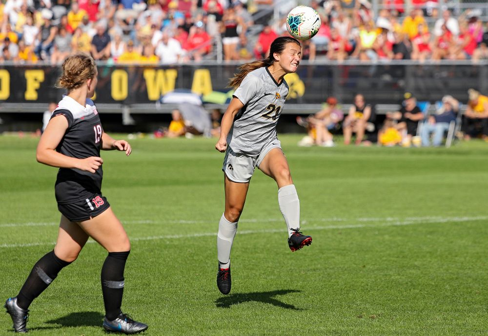 Iowa forward Emma Tokuyama (21) wins a header during the second half of their match at the Iowa Soccer Complex in Iowa City on Sunday, Sep 1, 2019. (Stephen Mally/hawkeyesports.com)