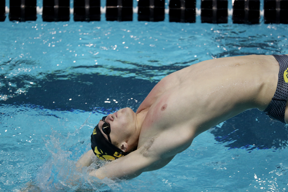 IowaÕs Ryan Purdy competes in the 100 yard backstroke against Notre Dame and Illinois Saturday, January 11, 2020 at the Campus Recreation and Wellness Center.  (Brian Ray/hawkeyesports.com)