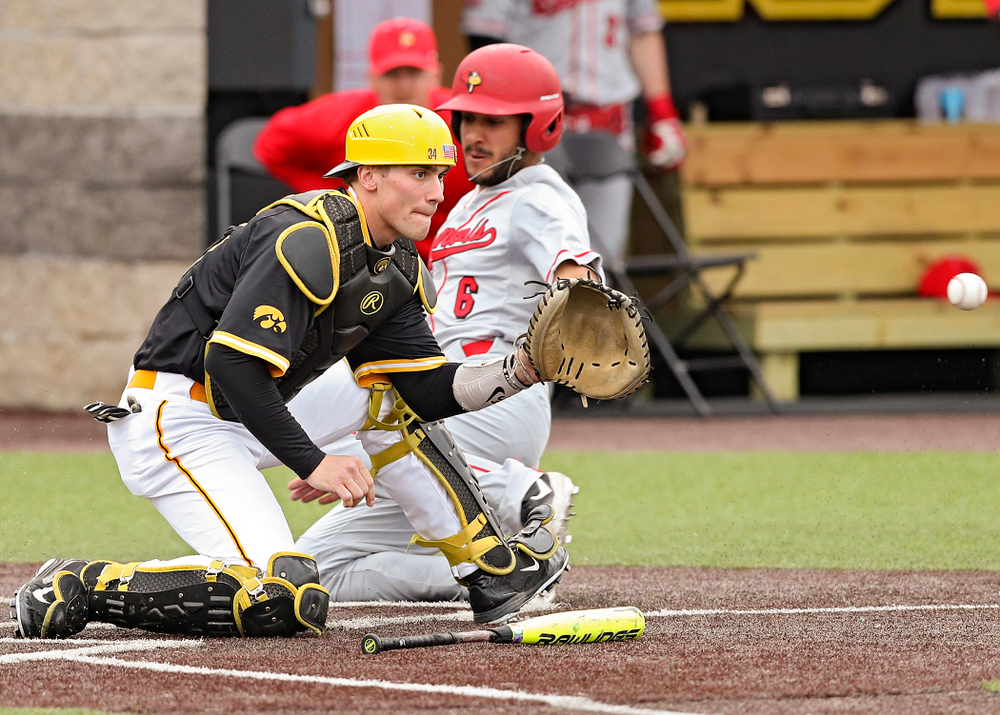 Iowa Hawkeyes catcher Austin Martin (34) looks in a throw during the third inning of their game against Illinois State at Duane Banks Field in Iowa City on Wednesday, Apr. 3, 2019. (Stephen Mally/hawkeyesports.com)