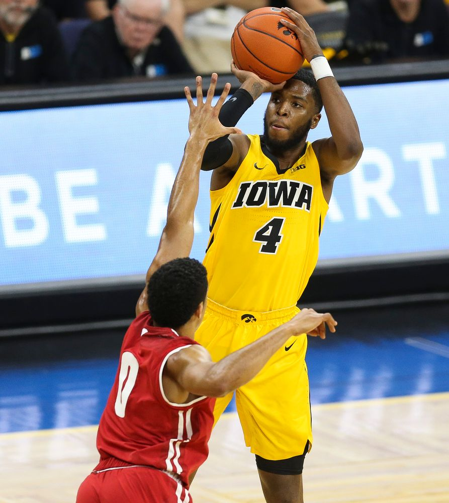 Iowa Hawkeyes guard Isaiah Moss (4) shoots the ball against Wisconsin on November 30, 2018 at Carver-Hawkeye Arena. (Tork Mason/hawkeyesports.com)
